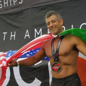 Akash Garg with a flag around his shoulders after spartan race