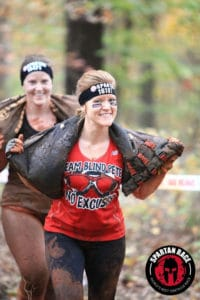 action shot of crystal pace competing in the Spartan Race