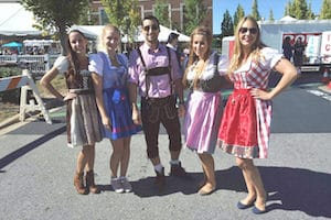 group photo of people dressed in german attire at Spartanburg's annual international festival