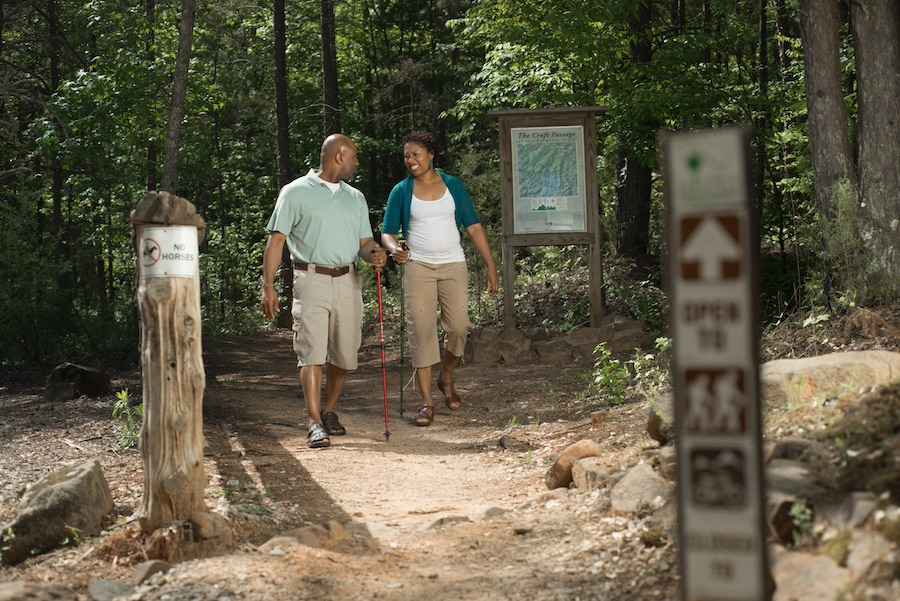 couple walking a trail in croft state park
