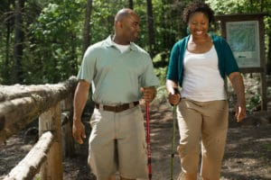 couple walking on an outdoor trail