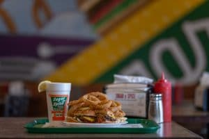 double cheeseburger, onion rings, and a sweet tea from sugar n spice